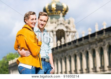 Tourist Couple, man and women, in Dresden at Zwinger castle