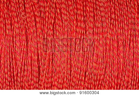 Spool Of Orange Thread Macro Background
