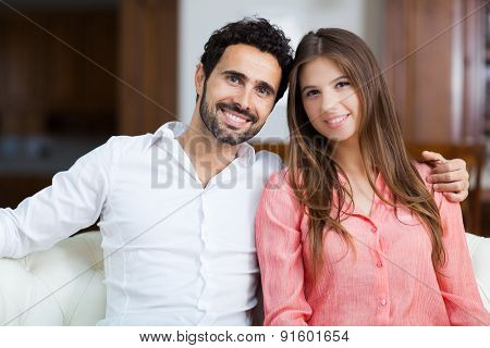 Young couple on the sofa in love