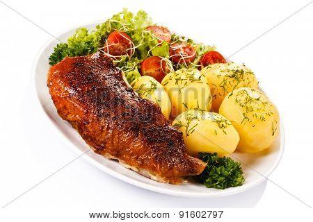 Roast duck fillet and vegetables