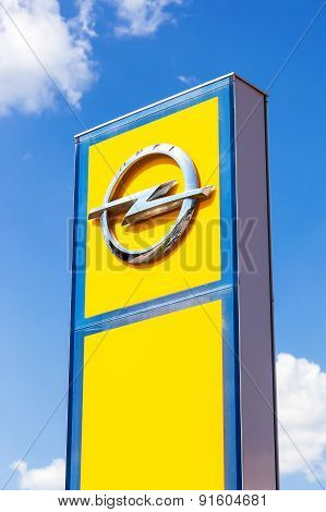 Opel Dealership Sign Against Blue Sky. Opel Is A German Automobile Manufacturer