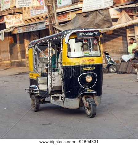 Auto Rickshaw Taxi Driver With Passengers In Operation