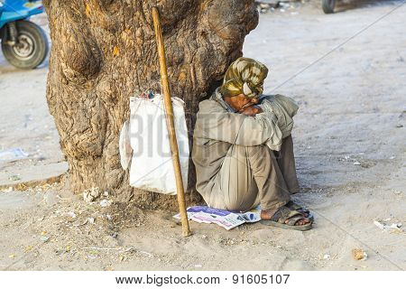 Indian Street Beggar Seeking Alms On The Street
