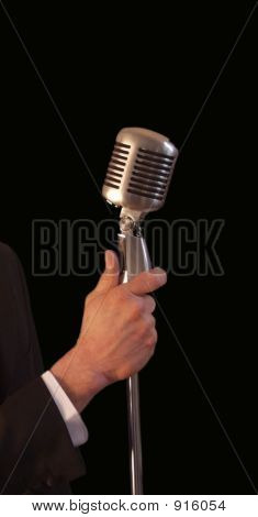 Singer Holding Vintage Microphone & Stand