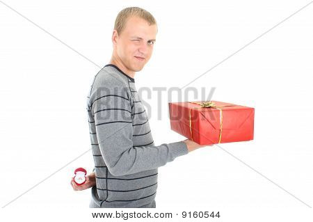 Man With Gift And Wedding Ring Winking