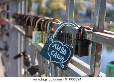 Svyatogorsk, Ukraine - October 12, 2014: Locks with the names of lovers on the bridge fixed