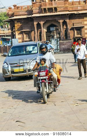 Man And Child On A Motorbike At The Sadar Market At The Clocktower