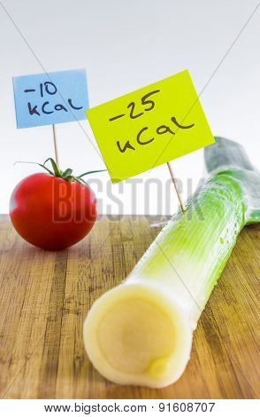 Negative calorie food; leeks and tomato, dieting concept
