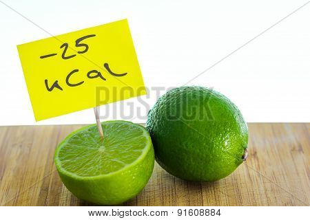 Negative-calories food, limes on a cutting board