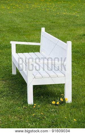 White Wooden Bench On Green Grass In Park