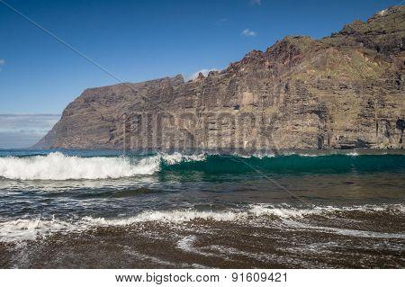 Black Sand And Big Waves At Los Guios Beach Near Los Gigantes Cliffs