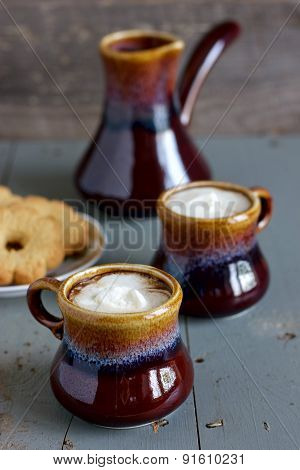 Iced Coffee In Brown And Gray Ceramic Cups