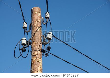 Wooden Column With Electric Wires Closeup