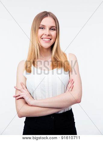 Cheerful businesswoman standing with arms folded isolated on a white background. Looking at camera