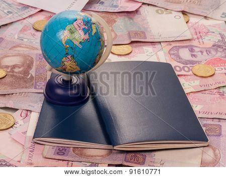Passport and globe on money