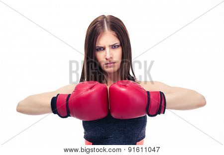 Serious sporty woman with boxing gloves isolated on a white background. Looking at camera