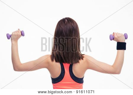 Back view portrait of a fitness woman working out with dumbbells isolated on a white backgorund