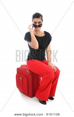 Businesswoman Sitting On Big Suitcase