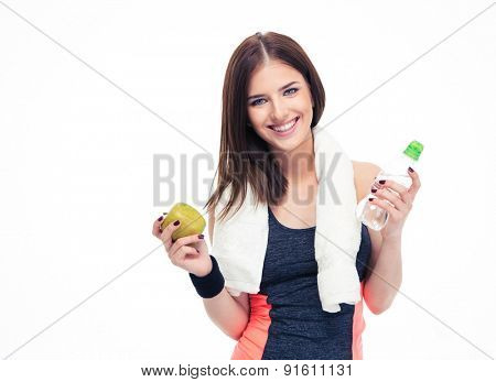 Fitness woman holding apple and bottle with water isolated on a white background