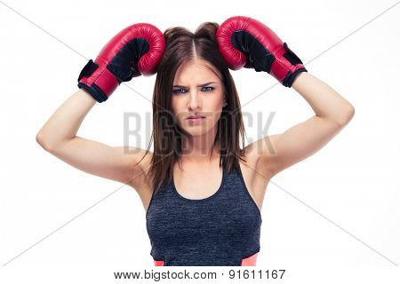 Portrait of a beautiful cute woman in boxing gloves isolated on a white background. Looking at camera