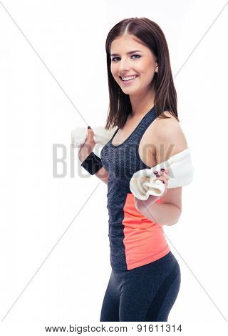 Portrait of a happy fitness woman with towel isolated on a white background. Looking at camera