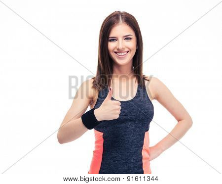 Happy fitness woman showing thumb up isolated on a white background and looking at camera
