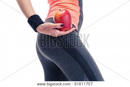 Closeup portrait of a woman`s body with apple isolated on a white background