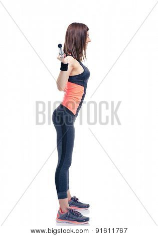 Side view portrait of a fitness woman working out with barbell isolated on a white background