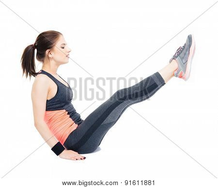 Young fitness woman making abdominal exercises on the floor isolated on a white background