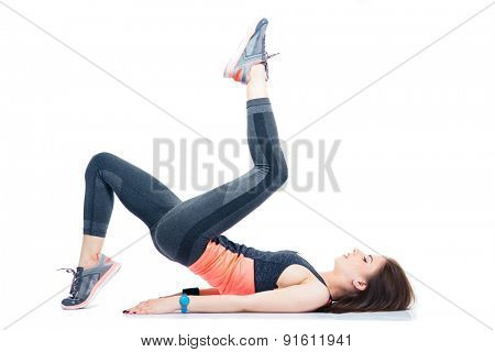 Sporty woman lying on the floor and doing exercises isolated on a whtie background