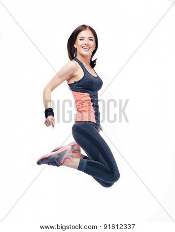 Happy sports woman jumping isolated on a white background. Looking at camera