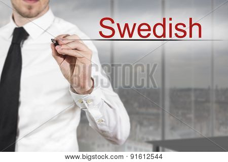 Businessman In Office Writing Swedish In The Air
