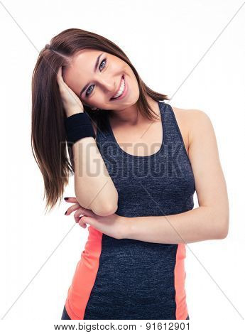 Portrait of a smiling young fitness woman isolated on a white background. Looking at camera