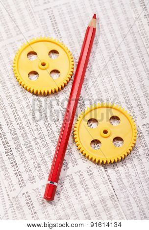Two Gears With A Red Pencil