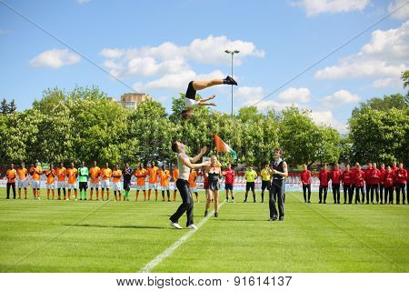 MOSCOW - MAY 14, 2014: Acrobatic performances during the opening of the International football tournament Cup of Victory in front of teams at the Spartakovets stadium in Moscow