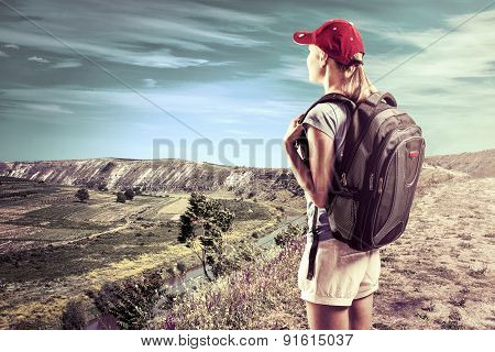 Female Climber Looking At Beautiful Mountain Landscape