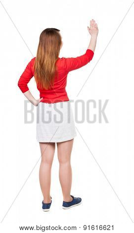 back view of standing young beautiful  woman. girl  watching. Rear view people collection. backside view person. Isolated over white background. Adding putting hands on waist stands and looks to right