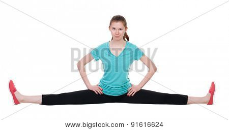 Front view of the girl in sportswear sitting on the longitudinal splits. Rear view people collection.   Isolated over white background. Pretty girl looks in the picture sitting on the splits.
