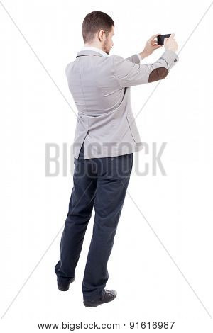 back view of business man on phone photographs. rear view people collection. Isolated over white background. backside view of person.  A bearded man in a suit photographed telephone.