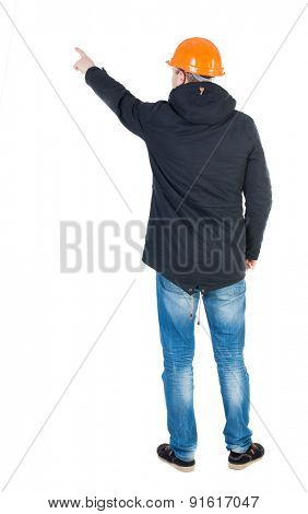 Back view of  pointing young men in parka and helmet. Young guy  gesture. Rear view people collection.  backside view of person.  Isolated over white background. Young engineer specifies left hand