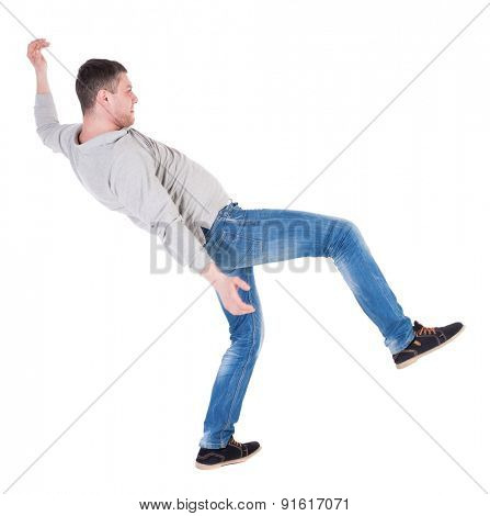Back view man Balances waving his arms. Rear view people collection. backside view of person.  Isolated over white background. the falling man balancing on one leg.