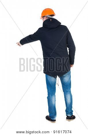 Back view of  pointing young men in parka and helmet. Young guy  gesture. Rear view people collection.  backside view person.  Isolated over white background. Young engineer specifies left hand down