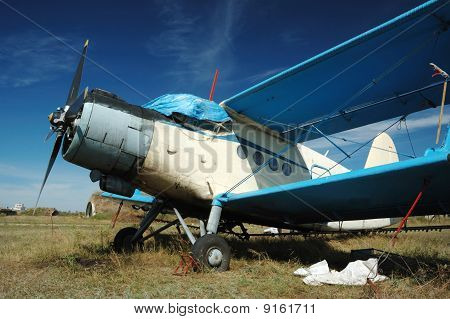 Old russian biplane An-2 at aerodrome, soviet airplane