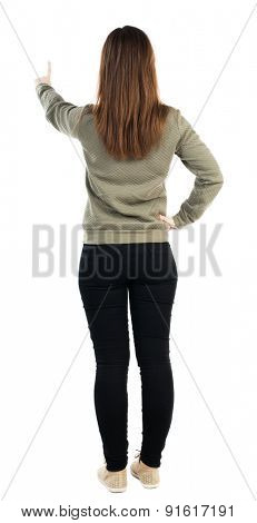 back view of standing young beautiful  woman in jeans looks down. girl  watching. Rear view people collection.  backside view of person.  Isolated over white background.