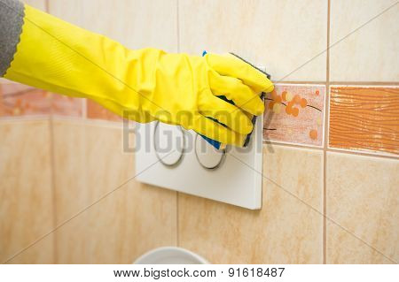 Housemaid Hand  Is Cleaning Bathroom