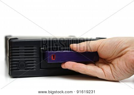 System Administrator Inserting A Backup Tape In A Backup Unit