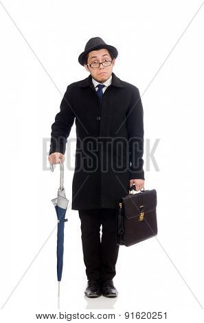 Young man holding suitcase and umbrella isolated on white