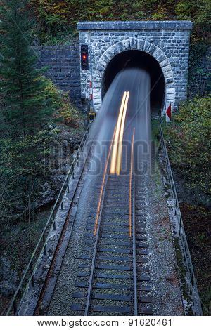 Old Brick Tunnel In The Mountains And Incoming Train