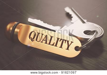Keys to Quality. Concept on Golden Keychain.