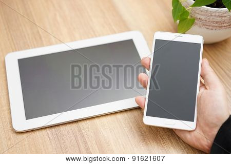 Tablet Pc And Mobile Phone In Hand